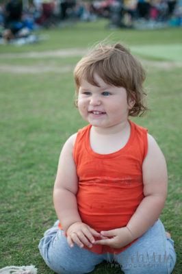 cute pic of toddler kneeling on grass