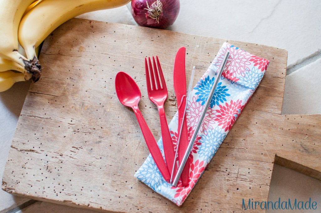 Red and blue floral pouch with red cutlery and stainless steel straw EcoEatz set
